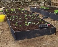 deluxe raised beds in a row from recycled plastic