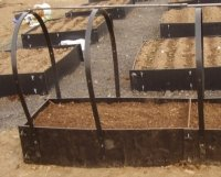 intermediate raised bed with raised bed protector frame