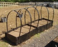 intermediate raised beds in a row with protector frames
