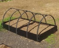 plastic standard raised bed in a row with protector frames